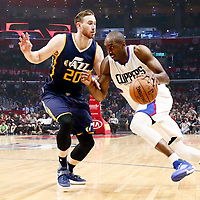 25 March 2016: LA Clippers forward Luc Mbah a Moute (12) drives past Utah Jazz forward Gordon Hayward (20) during the Los Angeles Clippers 108-95 victory over the Utah Jazz, at the Staples Center, Los Angeles, California, USA.