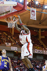 14 October 2006:  Six foot Three guard Nedu Onyeuku pumps the iron for a slaming 2 points.  Doug Collins retired jersey hangs overhead.  Below is Grant Stout.......In a game that involved both coaches as much as the players, the Northern Iowa Panthers plucked the Illinois State University Redbirds in a Missouri Valley Conference game by a score of 67 - 52. Competition took place at Redbird Arena in Normal Illinois