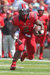 Sep 6, 2014; Piscataway, NJ, USA; Rutgers Scarlet Knights running back Desmon Peoples (6) runs with the ball during the first half at High Points Solutions Stadium.