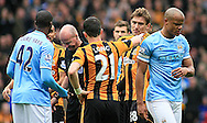 Ref M Mason shows the red card to Vincent Kompany (right) of Manchester City during the Barclays Premier League match at the KC Stadium, Kingston upon Hull<br /> Picture by Richard Gould/Focus Images Ltd +44 7855 403186<br /> 15/03/2014