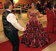 "Kent (left) and Sharon Arnett, from Laura, Ohio dance at the 2007 Wellness Connection Red Dress Gala, at the Schuster Performing Arts Center in Dayton, Saturday night, May 5th.  Owner of Sharnett's Bridal and Prom, Sharon is a Cardiac survivor.  In a letter published in the program book Sharon says, ""I had three heart attacks in my 30's.""  Because ""surgery is not an option,"" she's undergoing treatment for fibromuscular dysplasia with ""determination, and the right medication,"" and is working 80 hours a week in the bridal shop she founded in 2003."