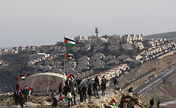 A Palestinian flag flutters as Palestinians, together with Israeli and foreign activists, stand near tents at an outpost named Bab al-Shams ( Gate of the Sun ) between Jerusalem and the Jewish settlement of Maale Adumim in the Israeli-occupied West Bank, in an area where Israel has vowed to build new settler homes, on Jan. 12, 2013. The Israeli occupation administration gave Palestinian activists an ultimatum to quit the protest camp in part of the West Bank, but hours after the deadline passed, there was no sign of any Israeli move to evict the protesters, January 12, 2013. Photo by Imago / i-Images...UK ONLY