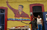 Caracas, Venezuela<br />Outside a workshop near Miraflores (the presidential palace) large mural shows support for Venezuelan president Hugo Chavez. Large murals depicting Chavez are sprouting up in Caracas, part of a growing cult of personality centred around Chavez.