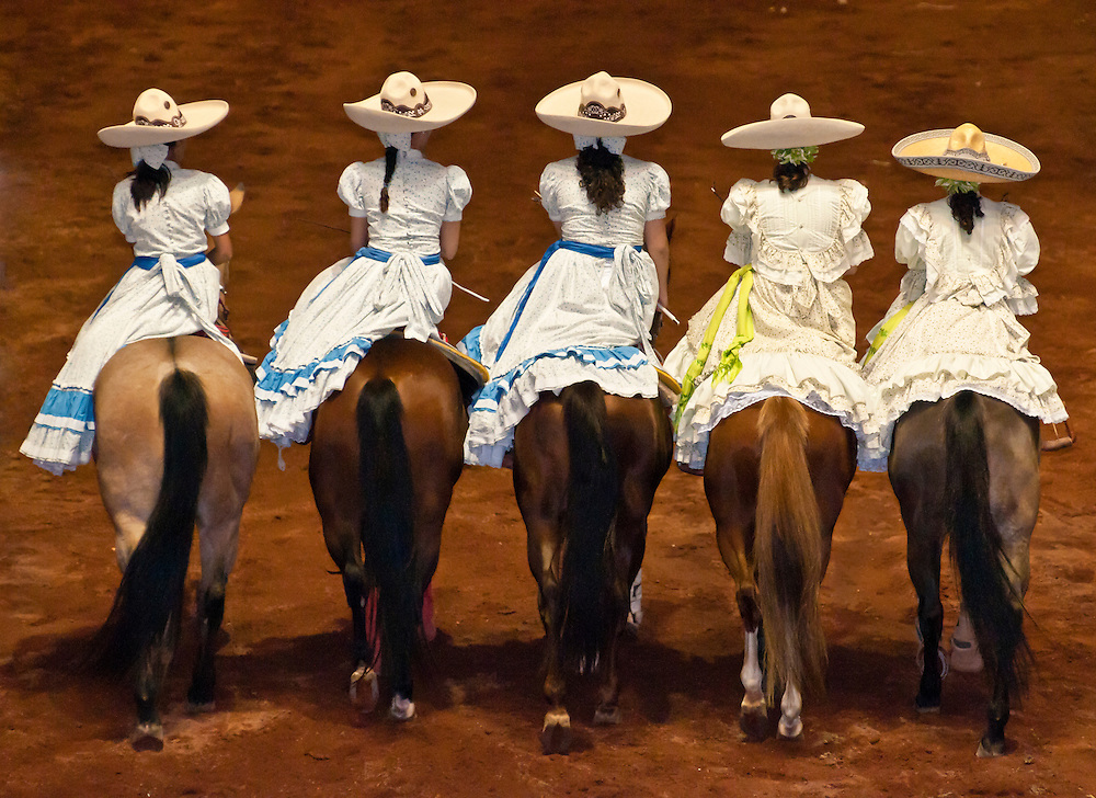 Women horse riders at Lienzo Charro charreada show, Guadalajara, Mexico.