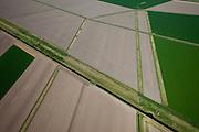 Nederland, Groningen, Oldambt, 08-09-2009; de Reiderwolderpolderdijk tussen  de Reiderwolderpolder uit 1870 en de later voltooide de Carel Coenraadpolder uit 1924 (boven). Beide polders zijn ontstaan door landaanwinning. .Reiderwolderpolder dike between the Reiderwolderpolder from 1870 and the later completed the Carel Coenraad polder from 1924 (above). Both polders were created through land reclamation..luchtfoto (toeslag); aerial photo (additional fee required); .foto/photo Siebe Swart