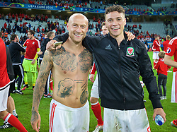 LILLE, FRANCE - Friday, July 1, 2016: Wales' David Cotterill and James Chester after the 3-1 victory over Belgium during the UEFA Euro 2016 Championship Quarter-Final match at the Stade Pierre Mauroy. (Pic by David Rawcliffe/Propaganda)