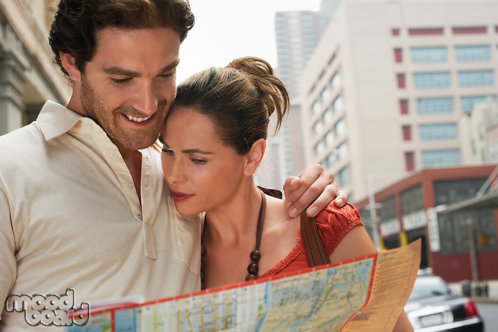 Couple Looking at City Map