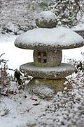 Snow falling on a stone lantern at the Asticou Azalea Garden, Northeast Harbor, Maine