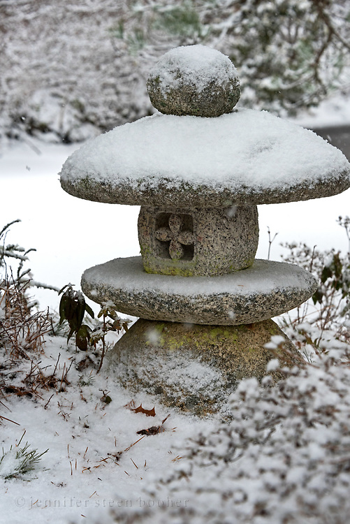 Snow falling on a stone lantern at the Asticou Azalea Garden, Northeast Harbor, Maine