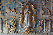 Assumption, coronation and litany of the Virgin, polychrome stone in high relief, 1511, restored 1888-95, from the East wall of the Chapel of Our Lady of the Assumption in the Collegiate Church of Saint-Gervais-Saint-Protais, built 12th to 16th centuries in Gothic and Renaissance styles, in Gisors, Eure, Haute-Normandie, France. The church was consecrated in 1119 by Calixtus II but the nave was rebuilt from 1160 after a fire. The church was listed as a historic monument in 1840. Picture by Manuel Cohen