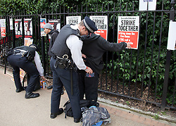 © Licensed to London News Pictures. LONDON, UK  30/06/11. Police search two men before the start of an anti-cuts protest in central' London. Around 20,000 protesters take to the streets of London to demonstrate against government public sector cutbacks. Please see special instructions for usage rates. Photo credit should read Matt Cetti-Roberts/LNP