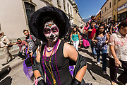 A woman in a Catrina costume celebrating the Day of the Dead festival known in Spanish as Día de Muertos at the town square October 31, 2013 in Oaxaca, Mexico.  The festival celebrates the lives of those that died.