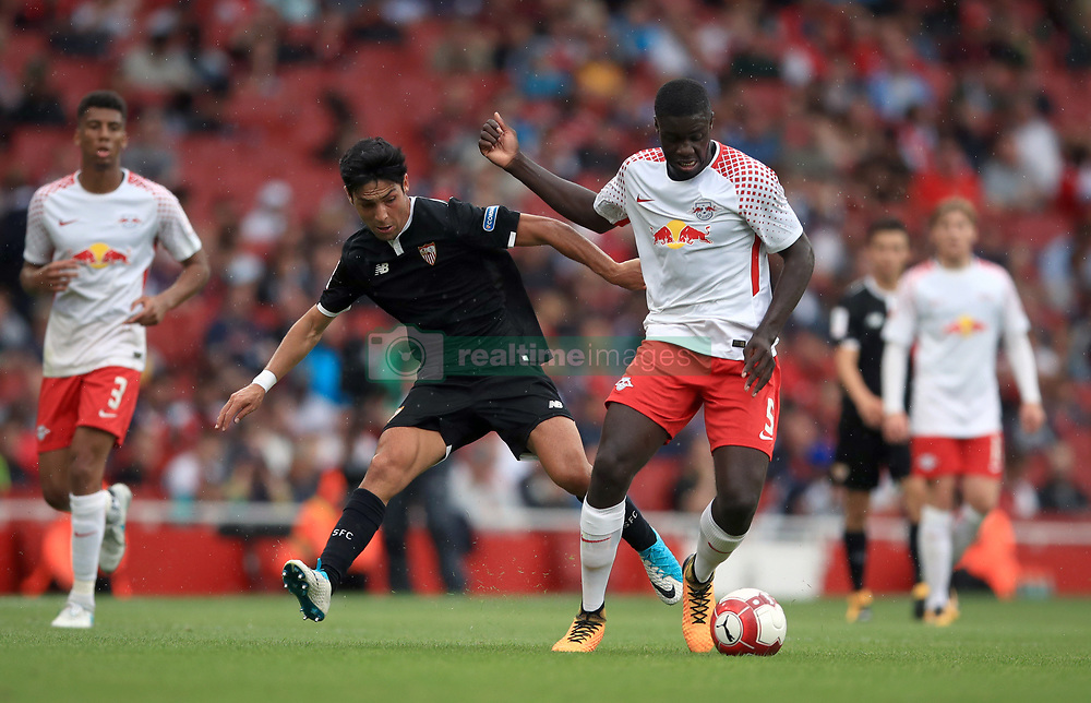 RB Leipzig's Dayot Upamecano (right) and Sevilla's Boria Lasso battle for the ball during the Emirates Cup match at the Emirates Stadium, London.