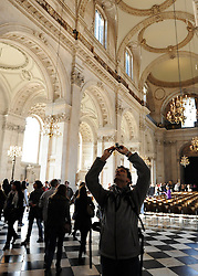 35559258© Licensed to London News Pictures. 28/10/2011. London, UK. A visitor photographs the ceiling. A Eucharist service held at St Paul's Cathedral today. St Paul's Cathedral reopened its doors at midday today. The Cathedral had been closed over health and safety fears from the Occupy London protest outside.  Photo: Stephen Simpson/LNP