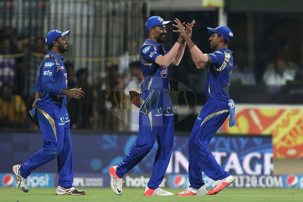 Hardik Pandya of Mumbai Indians is congratulated by J Suchith of Mumbai Indians for taking the catch to get Dwayne Smith of Chennai Super Kings wicket during match 43 of the Pepsi IPL 2015 (Indian Premier League) between The Chennai Super Kings and The Mumbai Indians held at the M. A. Chidambaram Stadium, Chennai Stadium in Chennai, India on the 8th May April 2015.<br /> <br /> Photo by:  Shaun Roy / SPORTZPICS / IPL
