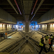 December 12, 2016 - New York, NY :  Train tracks crisscross as they wind through the Second Avenue subway tunnel just south of the 96th Street station. After years of delays, the new subway line is preparing to welcome its first straphangers. The governor, seen in brown jacket at right, visited the soon-to-open second avenue subway project on Monday morning with this photographer and New York Times reporter Emma G. Fitzsimmons.  CREDIT: Karsten Moran for The New York Times