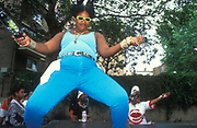 Woman dances on Clysdale Rd, Notting Hill Carnival, 1997.