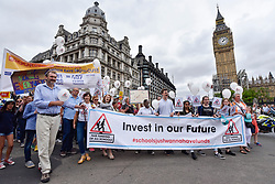 "© Licensed to London News Pictures. 16/07/2017. London, UK. Parents, pupils and teachers gather for an event called ""Carnival Against The Cuts"" in Parliament Square.  The demonstration, organised by Fair Funding For Schools, a parent led campaign, calls for the government to increase funding for schools.   Photo credit : Stephen Chung/LNP"