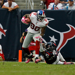 October 10, 2010; Houston, TX USA;Houston Texans cornerback Glover Quin (29) attempts to tackle New York Giants wide receiver Hakeem Nicks (88)during the second half at Reliant Stadium. The Giants defeated the Texans 34-10. Mandatory Credit: Derick E. Hingle
