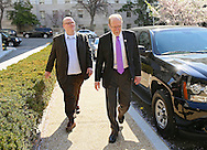 Representative Dave Loebsack (D-IA) walks with Communications Director Joe Hand outside the Longworth House Office Building in Washington, DC on Thursday, April 11, 2013.