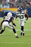 Seattle Seahawks rookie wide receiver David Moore (83) goes out for a pass while covered by Los Angeles Chargers rookie cornerback Brandon Stewart (39) during the 2017 NFL week 1 preseason football game against the against the Los Angeles Chargers, Sunday, Aug. 13, 2017 in Carson, Calif. The Seahawks won the game 48-17. (©Paul Anthony Spinelli)