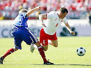 CHORZOW 01/06/2008.POLAND v DENMARK.INTERNATIONAL FRIENDLY.JACEK KRZYNOWEK OF POLAND IS FOULED BY PLAYER OF DENMARK ..FOT. PIOTR HAWALEJ / WROFOTO