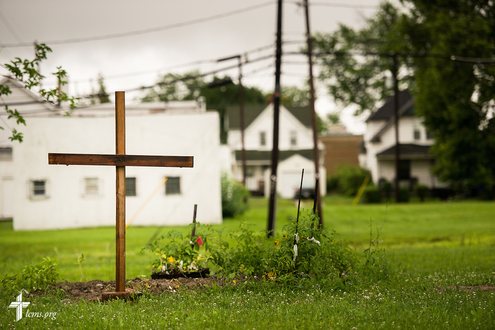 A cross and grave dots a neighborhood street on Thursday, July 9, 2015, in Toledo, Ohio. LCMS Communications/Erik M. Lunsford