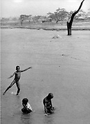 Boys playing in a river in Nigeria.