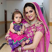 Hounslow, Greater London, UK, January 25, 2015. Sikh Temple Gurdjwara Sri Guru Singh Sobha.<br /> A portrait of Gurmeet with her daughter Ashreena during the celebrations of her 1st birthday party.
