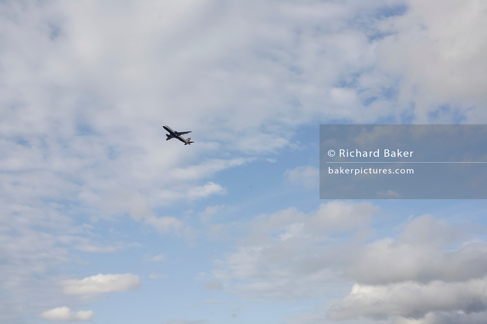 Part of a sequence of 8 consecutive images, a jet airliner takes-off over afternoon skies above London's Heathrow Airport.