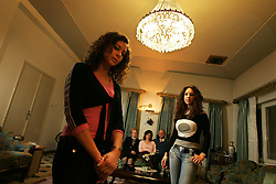 The Nashashibi family are seen inside their home, including, left to right, daughter Hala, 16, mother Widad, wife Marlene, head of family Fahmi and daughter Nada in Jerusalem, Israel, Feb. 12, 2005. The Nashashibi family are part of a Palestinian middle and upper class who are likely to have prominent roles in the developing peace process.