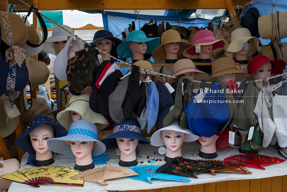 A stall selling hats and fans at the market in Vodnikov Square in the Slovenian capital, Ljubljana, on 27th June 2018, in Ljubljana, Slovenia.