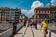 A woman begs as people cross the latin Bridge where Archduke Franz Ferdinand and his wife Sophie were assassinated in 1914 setting off World War I. Sarajevo is known for 3 major events in world history: the Assassination of the Archduke of Austria-Este,  the 1984 Winter Olympics and the longest sustained siege in modern history.
