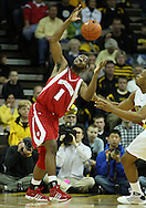 21 JANUARY 2009: Wisconsin's Marcus Landry (1) tries to grab a lose ball as Iowa's David Palmer (2) looks on during the first half of an NCAA college basketball game Wednesday, Jan. 21, 2009, at Carver-Hawkeye Arena in Iowa City, Iowa. Iowa defeated Wisconsin 73-69 in overtime.