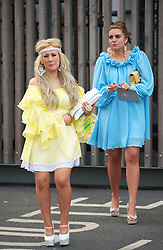 LIVERPOOL, ENGLAND - Friday, April 9, 2010: Two female race-goers on Ladies' Day during the second day of the Grand National Festival at Aintree Racecourse. (Pic by David Rawcliffe/Propaganda)