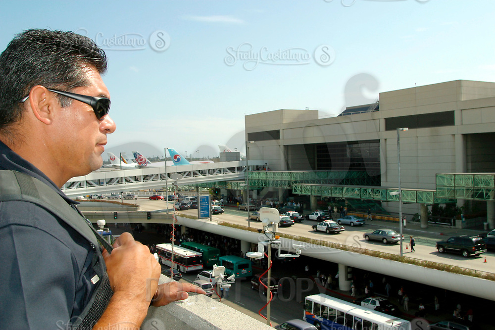 Jul 04, 2002; Los Angeles, CA, USA; LAPD sharp shooter helps to secure the Tom Bradley International terminal before allowing passengers to return at Los Angeles International airport where Egyptian gunman HESHAM MOHAMED HADAYET, 41, opened fire at the EL AL ticket counter where two civilians were killed and four others wounded.<br />Mandatory Credit: Photo by Shelly Castellano/ZUMA Press.<br />(&copy;) Copyright 2002 by Shelly Castellano
