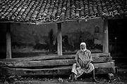 Man seated in front of an abandoned house in Nagore town.<br /> Tamil Nadu. South India.