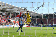 Shrewsbury Town Goal keeper Max O'Leary (25) takes ball safe from Rotherham United player Michael Smith (24) during the EFL Sky Bet League 1 match between Rotherham United and Shrewsbury Town at the AESSEAL New York Stadium, Rotherham, England on 21 September 2019.