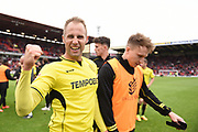 Burton Albion striker Luke Varney (19) celebrates Burton Albion staying in the Championship in only their first season in the second tier during the EFL Sky Bet Championship match between Barnsley and Burton Albion at Oakwell, Barnsley, England on 29 April 2017. Photo by Richard Holmes.