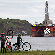 Greenpeace activists board a BP oil rig in Cromarty Firth to stop it from further oil drilling at sea, June 10th 2019, Cromarty, Scotland, United Kingdom. The oil rig 'Paul B. Loyd, Jnr', owned by Transocean, was due to head to BP's Vorlich field, 150 miles (241km) east of Aberdeen to drill for oil for BP. Onlookers watch the occupied oil rig.The occupation by Greenpeace activists subsequently delayed the departure for 5 days and 14 activists were arrested in the process. Greenpeace says that in an age of climate emergency BP should not be drilling for new oil but look for non-fossil fuel means of energy.