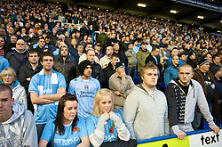 BIRMINGHAM, ENGLAND - Sunday, November 1, 2009: Manchester City's supporters stand for a minute's silence before the Premiership match against Birmingham City at St Andrews. (Pic by David Rawcliffe/Propaganda)