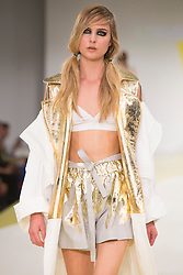 © Licensed to London News Pictures. 01/06/2015. London, UK. Collection by Lowri Edwards. Fashion show of De Montfort University (Leicester) at Graduate Fashion Week 2015. Graduate Fashion Week takes place from 30 May to 2 June 2015 at the Old Truman Brewery, Brick Lane. Photo credit : Bettina Strenske/LNP