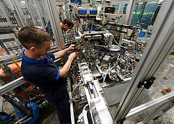 Philips' technicians, services one of the robotic machines used to manufacture ceramic metal halide lamps, at the Philips Lighting factory, in Turnhout, Belgium, on Friday, Oct. 15, 2010. (Photo © Jock Fistick)