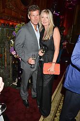 "AMANDA WAKELEY and HUGH MORRISON at the presentation of Le Prix Champagne De La Joie de Vivre to Stephen Webster in celebration of his long standing contribution to ""Joie de Vivre' held at the Council Room, One Great George Street, London on 22nd April 2015."