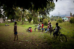 Young children watch a soccer match on January 15, 2013 in San Juan, Honduras.  (David Rochkind/ Pulitzer Center)