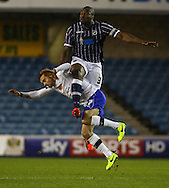 Picture by David Horn/Focus Images Ltd +44 7545 970036<br /> 28/01/2014<br /> Danny Shittu of Millwall (right) in an aerial battle with Stephen McPhail of Sheffield Wednesday during the Sky Bet Championship match at The Den, London.