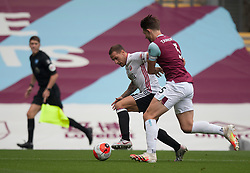 Billy Sharp of Sheffield United (L) and James Tarkowski of Burnley in action - Mandatory by-line: Jack Phillips/JMP - 05/07/2020 - FOOTBALL - Turf Moor - Burnley, England - Burnley v Sheffield United - English Premier League