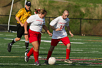 Jillian McDonald makes a pass to Neco Russell during LHS Unified Soccer with Winnisquam on Monday afternoon.  (Karen Bobotas/for the Laconia Daily Sun)