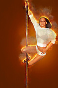 Digitally enhanced image of an erotic pole dancer in a nightclub