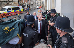 © Licensed to London News Pictures. 08/08/2018. Bristol, UK. England cricketer BEN STOKES (Centre) arrives at Bristol Crown court today past media and police for the third day of his trial on charges of affray that relate to a fight outside a Bristol nightclub on September 25 2017. Stokes and two other men, Ryan Ali, 28, and Ryan Hale, 27, all deny the charge. Stokes, Ali and Hale are jointly charged with affray in the Clifton Triangle area of Bristol on September 25 last year, several hours after England had played a one-day international against the West Indies in the city. A 27-year-old man allegedly suffered a fractured eye socket in the incident. Photo credit: Simon Chapman/LNP